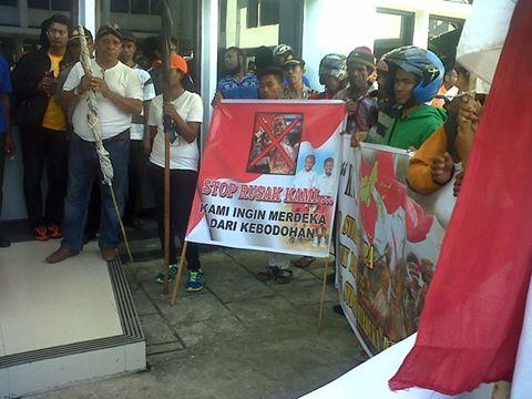 Militia Call Barisan Merah Putih Holding Banner In Jayapura