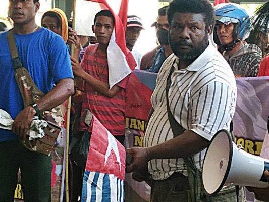 One of Barisan Merah Putih Holding West Papua Flag