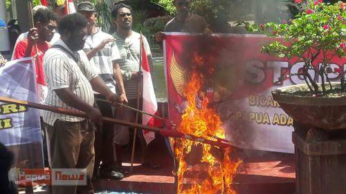 Members of Barisan Merah Putih Burning down West Papua and KNPB Flag